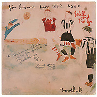 """BNPS.co.uk (01202 558833)<br /> Pic: RRAuction/BNPS<br /> <br /> Pictured: The album cover.<br /> <br /> An album cover John Lennon drew on and gifted to a session musician has emerged for sale 45 years later for £11,000. ($15,000)<br /> <br /> The Beatle did a self-portrait and sketches of a sheep chasing a dog on the front of the signed Walls and Bridges album.<br /> <br /> He presented it to guitarist Ed Mottau, who played the instrument on that album and Rock 'n' Roll, during a 1976 studio session.<br /> <br /> Lennon suggested Mottau pass the cover on to his children, writing the inscription: """"To Christine and Edward, with love from your Dad's pal, John Lennon, '76'."""""""