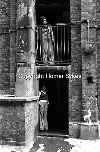 Tower Hamlets Whitechapel east London UK 1970s. Peabody social housing estate residents looking out onto the  communal courtyard. 1975