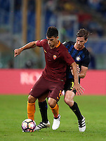 Calcio, Serie A: Roma vs Inter. Roma, stadio Olimpico, 2 ottobre 2016.<br /> Roma's Diego Perotti, left, is challenged by FC Inter's Cristian Ansaldi during the Italian Serie A football match between Roma and FC Inter at Rome's Olympic stadium, 2 October 2016.<br /> UPDATE IMAGES PRESS/Isabella Bonotto
