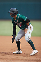Nick Gonzales (2) of the Greensboro Grasshoppers takes his lead off of first base against the Winston-Salem Dash at Truist Stadium on August 11, 2021 in Winston-Salem, North Carolina. (Brian Westerholt/Four Seam Images)