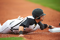 Alabama State Hornets Carlos Ocasio (2) slides face first into third during a game against the Ball State Cardinals on February 18, 2017 at Spectrum Field in Clearwater, Florida.  Ball State defeated Alabama State 3-2.  (Mike Janes/Four Seam Images)