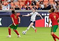 HOUSTON, TX - JUNE 10: Rose Lavelle #16 of the United States attempts to pass the ball to a teammate during a game between Portugal and USWNT at BBVA Stadium on June 10, 2021 in Houston, Texas.