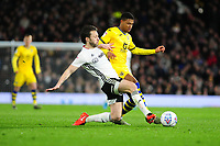 Rhian Brewster of Swansea City is tackled by Harry Arter of Fulham during the Sky Bet Championship match between Fulham and Swansea City at Craven Cottage on February 26, 2020 in London, England. (Photo by Athena Pictures/Getty Images)