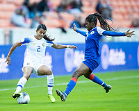 HOUSTON, TX - JANUARY 31: Batcheba Louis #7 of Haiti defends against Gabriela Guillen #2 of Costa Rica during a game between Haiti and Costa Rica at BBVA Stadium on January 31, 2020 in Houston, Texas.