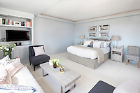 Contemporary bedroom with relaxing area