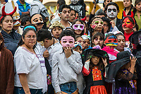 Oaxaca, Mexico, North America.  Day of the Dead Celebrations.  Oaxacans Observing a Children's Performance, to Celebrate All Souls Day, in the Zocalo, or Town Square.