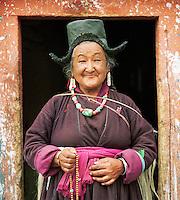 Local woman holding prayer beads, Ladakh, India