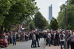 """© Joel Goodman - 07973 332324 . 28/08/2015 . Salford , UK . People on Churchill Way as the procession approaches . The funeral of Paul Massey at St Paul's CE Church in Salford . Massey , known as Salford's """" Mr Big """" , was shot dead at his home in Salford last month . Photo credit : Joel Goodman"""