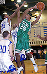 WATERBURY, CT. 06 January 2006-010606SV12--#25 Tyrone Flemming of Wilby High goes up for a shot as #23 B.J. Monteiro, and #32 Damian Saunders of Crosby High defend during NVL action in Waterbury Friday. <br /> (please use credit, not archive)<br /> Steven Valenti Republican-American