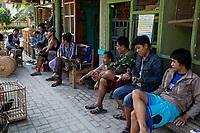 Yogyakarta, Java, Indonesia.  Javanese Men Resting and Talking in the Bird Market.