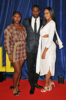 """Isan Elba, Idris Elba and Sabrina Dhowre at the 65th BFI London Film Festival """"The Harder They Fall"""" opening gala,Royal Festival Hall, Belvedere Road, on Wednesday 06th October 2021, in London, England, UK. <br /> CAP/CAN<br /> ©CAN/Capital Pictures"""