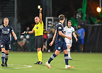 LAKE BUENA VISTA, FL - AUGUST 01: Referee Robert Sibiga shows a yellow card to Alexander Ring #8 of New York City FC during a game between Portland Timbers and New York City FC at ESPN Wide World of Sports on August 01, 2020 in Lake Buena Vista, Florida.