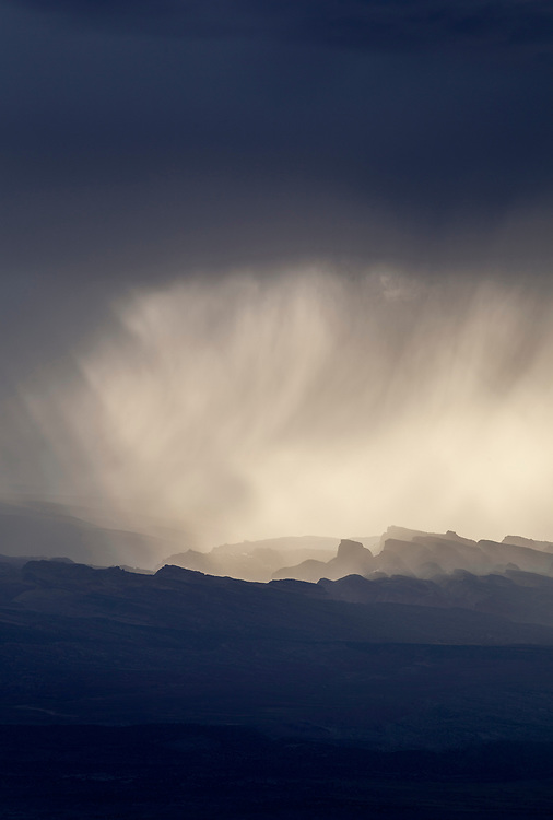 Monsoon storm over Capital Reef National Park near sunset creates spectacular light beams