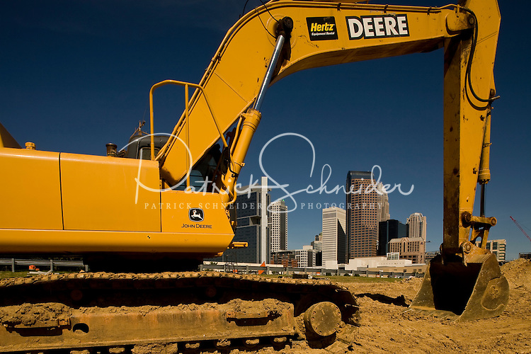 John Deere construction equipment waits to be used in uptown Charlotte, NC.