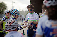 Michael Matthews (AUS/Orica-GreenEDGE) signing autographs for kids waiting outside the Giro 2015 Official Team Presentation (in San Remo)