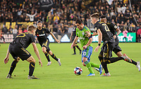 LOS ANGELES, CA - OCTOBER 29: Nicolas Lodeiro #10 of Seattle Sounders FC moves past Mark-Anthony Kaye #14, Walker Zimmerman #25 and Tristan Blackmon #27 of Los Angeles FC during a game between Seattle Sounders FC and Los Angeles FC at Banc of California Stadium on October 29, 2019 in Los Angeles, California.