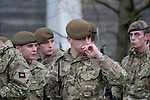 A soldier from the Prince of Wales Company 1st Battalion Welsh Guards wipes his nose after marching through the streets of Swansea in South Wales this afternoon. The homecoming parade was for soldiers who have returned from a tour of Helmand Province in Afghanistan between March and October last year.