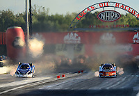 Sept 8, 2012; Clermont, IN, USA: NHRA funny car driver Cruz Pedregon (right) races alongside Robert Hight during qualifying for the US Nationals at Lucas Oil Raceway. Mandatory Credit: Mark J. Rebilas-