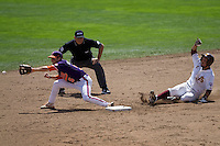 Arizona State's Raoul Torrez slides into second in Game 4 of the NCAA Division One Men's College World Series on Monday June 21st, 2010 at Johnny Rosenblatt Stadium in Omaha, Nebraska.  (Photo by Andrew Woolley / Four Seam Images)