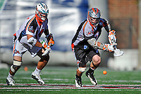 23 August 2008: Denver Outlaws' Midfielder Geoff Snider (7) races Los Angeles Riptide Midfielder Anthony Kelly (34) for possession during the Semi-Finals of the Major League Lacrosse Championship Weekend at Harvard Stadium in Boston, MA. The Outlaws edged out the Riptide 13-12, advancing to the upcoming Championship Game.. .Mandatory Photo Credit: Ed Wolfstein Photo