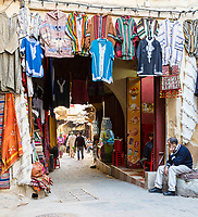 Fes, Morocco.  Street Scene in the Medina.  Clothes for Sale.