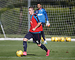 Liam Burt training with the first team after impressive performances with the youths at Rangers