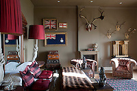 One of the bedrooms at Aynhoe Park is reminiscent of an explorer's home, with its battered leather suitcases and hunting trophies mounted on the wall