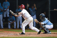 Ball State Cardinals Zach Plesac (11) squares to bunt in front of catcher Jonathan Salcedo (99) during a game against the Maine Black Bears on March 3, 2015 at North Charlotte Regional Park in Port Charlotte, Florida.  Ball State defeated Maine 8-7.  (Mike Janes/Four Seam Images)