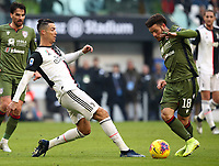 Calcio, Serie A: Juventus - Cagliari, Turin, Allianz Stadium, January 6, 2020.<br /> Juventus' Cristiano Ronaldo (l) in action with Cagliari's Nathan Nandez (r) during the Italian Serie A football match between Juventus and Cagliari at Torino's Allianz stadium, on January 6, 2020.<br /> UPDATE IMAGES PRESS/Isabella Bonotto