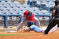 FCL Twins third baseman Wander Valdez (1) tags Shane Sasaki (37) out during a game against the FCL Rays on July 20, 2021 at Charlotte Sports Park in Port Charlotte, Florida.  (Mike Janes/Four Seam Images)