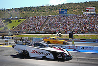 Jul. 21, 2013; Morrison, CO, USA: NHRA funny car driver Cruz Pedregon (near lane) races alongside Del Worsham during the Mile High Nationals at Bandimere Speedway. Mandatory Credit: Mark J. Rebilas-