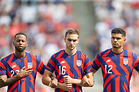 KANSAS CITY, KS - JULY 18: Kellyn Acosta #23 James Sands #16 Miles Robinson #12 of the United States during a game between Canada and USMNT at Children's Mercy Park on July 18, 2021 in Kansas City, Kansas.