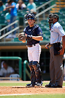 Montgomery Biscuits catcher Brett Sullivan (7) in front of home plate umpire Edwin Moscoso during a game against the Biloxi Shuckers on May 8, 2018 at Montgomery Riverwalk Stadium in Montgomery, Alabama.  Montgomery defeated Biloxi 10-5.  (Mike Janes/Four Seam Images)