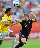 Amy Le Peilbet (r) of team USA and Francielle of team Brazil during the FIFA Women's World Cup at the FIFA Stadium in Dresden, Germany on July 10th, 2011.