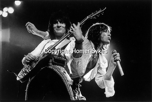 Mick Jagger & Ronnie Wood of The Rolling Stones, London, UK, 1976. Earls Court concert. 1970s UK