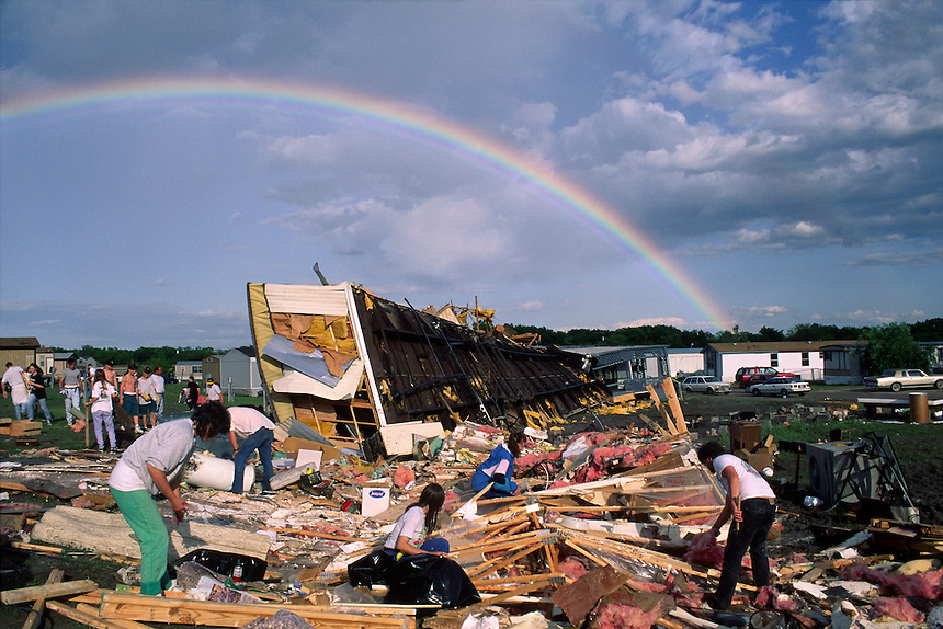 Bystanders collect worldly possessions from a destroyed mobile home where one person was killed when a tornado struck Wylie Texas on May 9th, 1993.