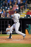 Colorado Springs Sky Sox left fielder Kyle Wren (5) follows through on a swing during a game against the Oklahoma City Dodgers on June 2, 2017 at Chickasaw Bricktown Ballpark in Oklahoma City, Oklahoma.  Colorado Springs defeated Oklahoma City 1-0 in ten innings.  (Mike Janes/Four Seam Images)