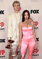 """HOLLYWOOD, CA - MAY 27:  Machine Gun Kelly and Megan Fox with the award for Alternative Rock Album of the Year at the 2021 """"iHeartRadio Music Awards"""" airing live from The Dolby Theatre in Los Angeles, Thursday, May 27 (8:00-10:00 PM ET live / PT tape-delayed) on FOX. CR: Scott Kirkland/FOX/PictureGroup © 2021 FOX MEDIA, LLC. (Photo by Scott Kirkland/FOX/PictureGroup)"""