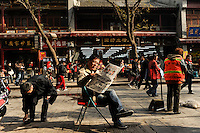 CHINA, Province Shaanxi, city Xian, shopping street and newspaper reader