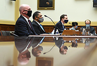 R. Clarke Cooper, Assistant Secretary of State for Political-Military Affairs, Brian Bulatao, Under Secretary of State for Management and Marik String, Acting Legal Adviser for the State Department, (L to R), testify before a House Committee on Foreign Affairs hearing looking into the firing of State Department Inspector General Steven Linick, on Capitol Hill in Washington, D.C. on Wednesday, September 16, 2020.  <br /> Credit: Kevin Dietsch / Pool via CNP /MediaPunch