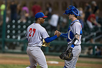Stockton Ports relief pitcher Miguel Romero (27) and catcher Jonah Heim (13) congratulate each other after a California League game against the Visalia Rawhide at Visalia Recreation Ballpark on May 8, 2018 in Visalia, California. Stockton defeated Visalia 6-2. (Zachary Lucy/Four Seam Images)