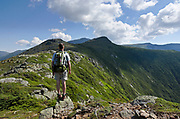 Solo hiker takes in the view of Mount Washington from along the Crawford Path (Appalachian Trail) in the White Mountains of New Hampshire during the summer months.