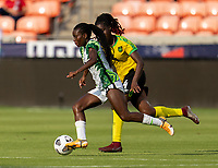 HOUSTON, TX - JUNE 10: Toni Payne #9 of Nigeria  dribbles the ball during a game between Nigeria and Jamaica at BBVA Stadium on June 10, 2021 in Houston, Texas.