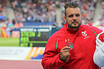 Glasgow 2014 Commonwealth Games<br /> Aled Davies (Wales) with his silver medal won in the Men's Para-Sport Discus Throw.<br /> Hampden Park<br /> 28.07.14<br /> ©Steve Pope-SPORTINGWALES