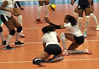 BOGOTÁ-COLOMBIA, 07-01-2020: Winderleys Medina y Aleoscar Blanco de Venezuela, se lanzan para tratar de salvar el balón durante partido entre Venezuela y Colombia en el Preolímpico Suramericano de Voleibol, clasificatorio a los Juegos Olímpicos Tokio 2020, jugado en el Coliseo del Salitre en la ciudad de Bogotá del 7 al 9 de enero de 2020. / Winderleys Medina and Aleoscar Blanco from Venezuela, dive to try and save the ball during a match between Venezuela and Colombia, in the South American Volleyball Pre-Olympic Championship, qualifier for the Tokyo 2020 Olympic Games, played in the Colosseum El Salitre in Bogota city, from January 7 to 9, 2020. Photo: VizzorImage / Luis Ramírez / Staff.