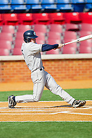 Corbin Blakey #5 of the Georgetown Hoyas follows through on his swing against the Delaware State Hornets at Gene Hooks Field on February 26, 2011 in Winston-Salem, North Carolina.  Photo by Brian Westerholt / Four Seam Images