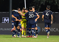 LAKE BUENA VISTA, FL - JULY 26: Tim Melia of Sporting KC is surrounded by teammates following the shootout during a game between Vancouver Whitecaps and Sporting Kansas City at ESPN Wide World of Sports on July 26, 2020 in Lake Buena Vista, Florida.
