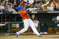 Florida Gators first baseman Peter Alonso (20) swings the bat against the Virginia Cavaliers in Game 13 of the NCAA College World Series on June 20, 2015 at TD Ameritrade Park in Omaha, Nebraska. The Cavaliers beat the Gators 5-4. (Andrew Woolley/Four Seam Images)