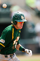 Baylor Bears shortstop Jake Miller #20 sprints to first base after laying down a bunt during the NCAA Regional baseball game against Oral Roberts University on June 3, 2012 at Baylor Ball Park in Waco, Texas. Baylor defeated Oral Roberts 5-2. (Andrew Woolley/Four Seam Images)