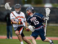 Max Schmidt (9) of Maryland moves in on Rob Fitzpatrick (15) of Penn at Ludwig Field in College Park, Maryland.